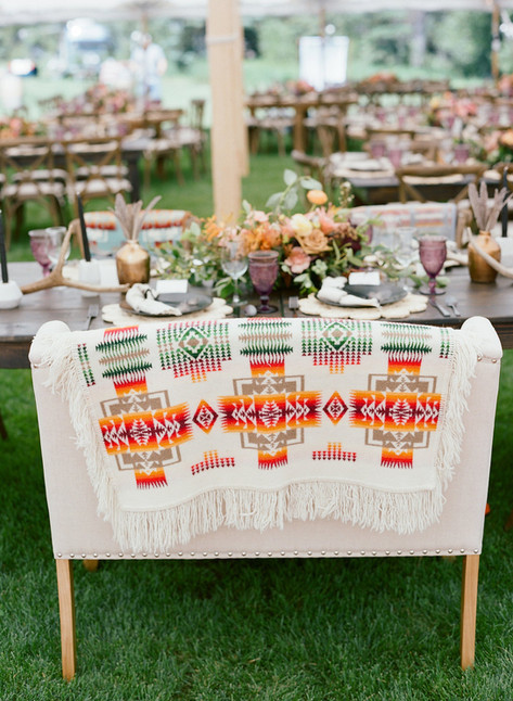 White Loveseat with Pendleton Blanket at Wedding Reception