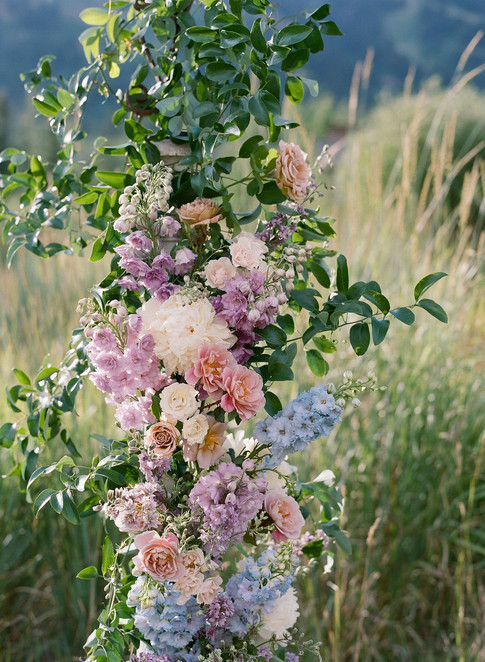 Pink and Purple Flowers on a Wedding Arch