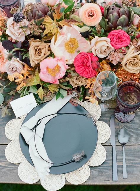 Pink and Cocoa Colored Flowers with a Black Plate and Scalloped Straw Charger