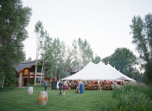 White Sailcloth Tent in a Large Green Yard