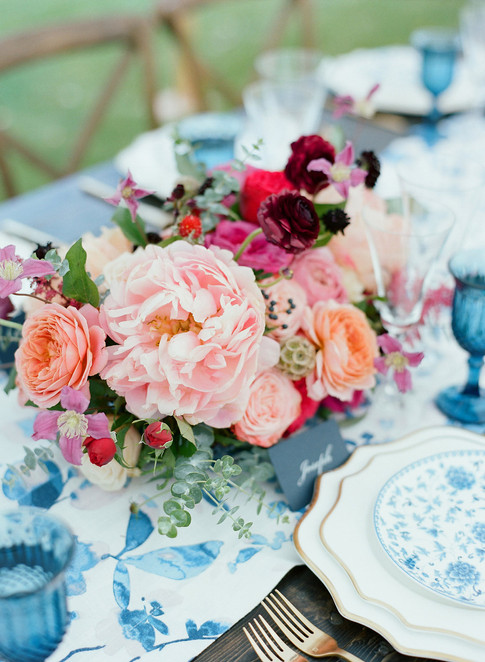Pink Flower Arrangement with Peonies on a Blue Patterned Table Runner