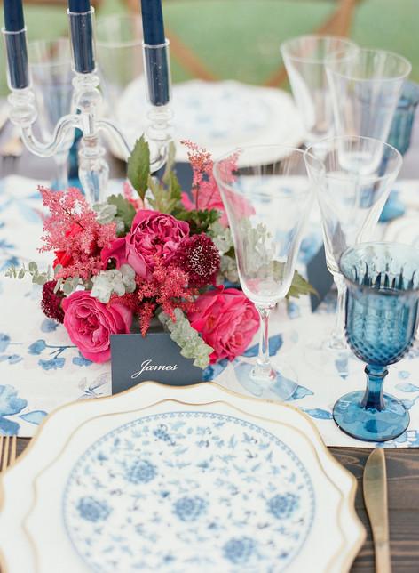 Tablesetting with Blue Patterened Plate, Blue Glassware and an Arrangement of Pink Peonies, Roses, and Astilbe
