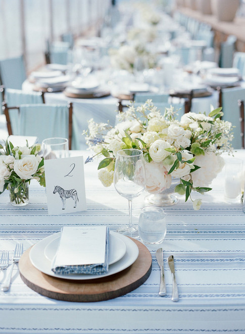 Wedding Reception Table Setting with Wooden Charger, White Plate and Silver Flatware