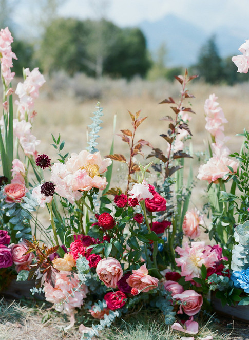 Wedding Aisle Flowers with Bright Pink Roses, Peonies and Greenery