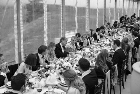 Long Table of People Eating and Drinking at a Wedding Celebration