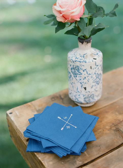 Blue Paper Napkins with a Patterned Blue Vase and a Single Pink Rose
