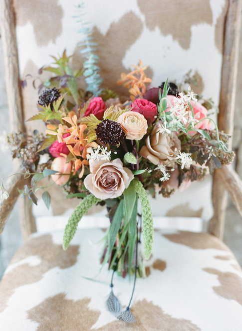 Pink, Purple and Green Bridal Bouquet on a Cowhide Chair