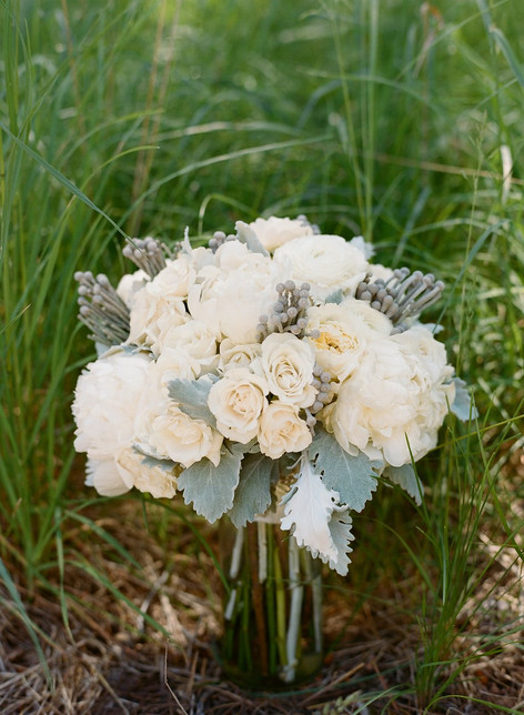 Bridal Bouquet with White Roses and Brunia Berries Sitting in Grass