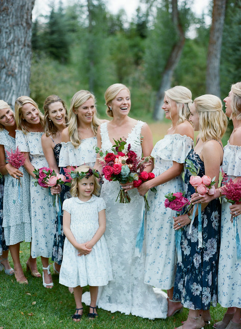 Bride and Bridesmaids in the woods with Bright Pink bouquets