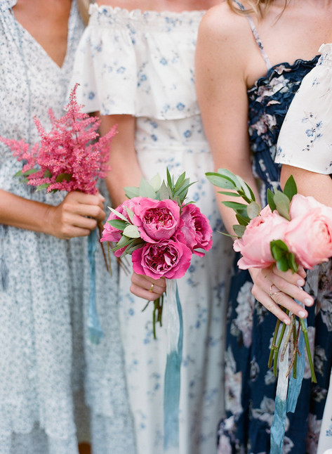 Three Bridesmaids holding single element bouquets of Pink Peonies, Pink Roses and Pink Astilbe