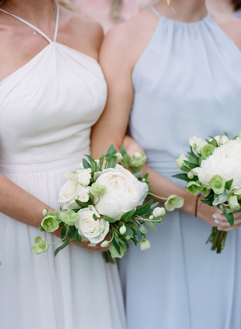 Bridesmaid holding a small bouquet with White Peonies and Hellebore
