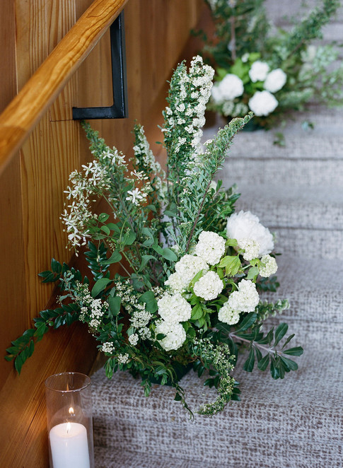 Large Green and White Wedding Aisle Arrangement on a Staircase