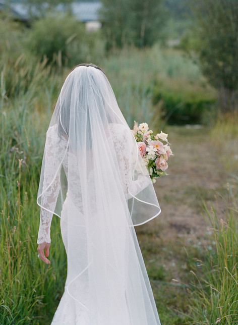 Bride Walking Away Holding Flower Bouquet