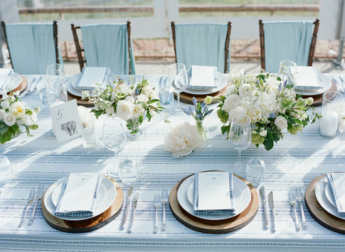 White and Green Flowers on a Light Blue Linen with Wooden Chargers