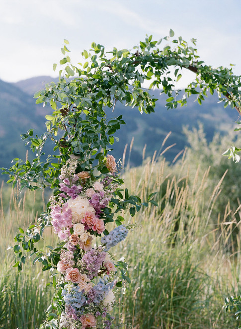 Pink and Purple Flowers with Greenery on a Wedding Arch