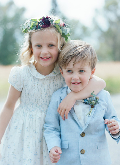 Young Flower Girl and Ring Bearer Hugging