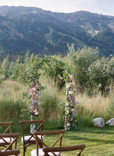 Flower arch in front of the Teton Mountains