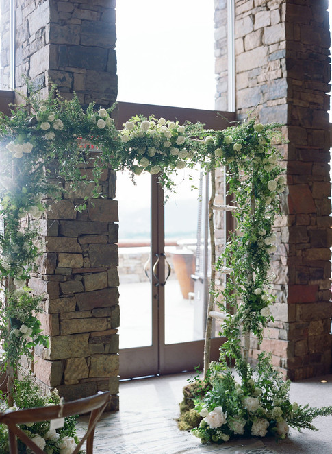 Wedding Arch with Wild Greenery and White Roses and Peonies