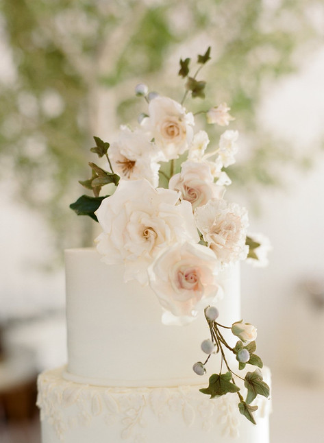 White Wedding Cake with White Roses and Brunia Berry