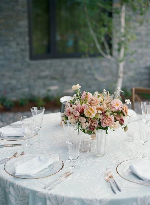 Light Pink Floral Centerpiece on a Light Blue Tablecloth