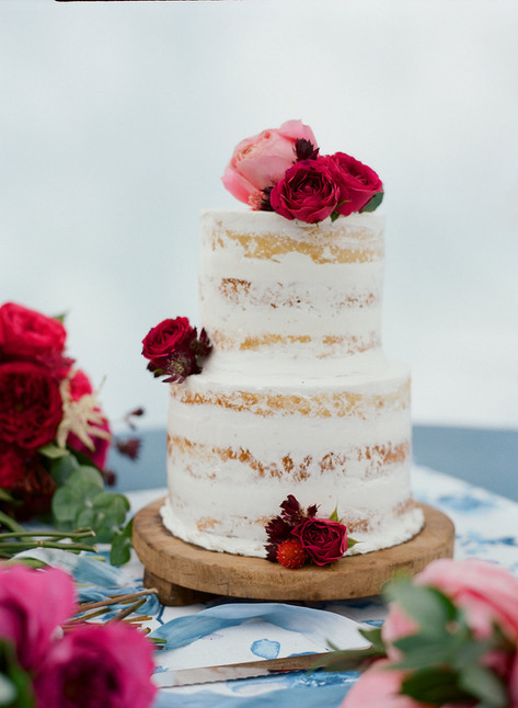 Two Tiered White Wedding Cake with Burgundy and Pink Roses