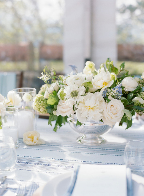 White and Green Flowers in a Silver Bowl on Light Blue Linens