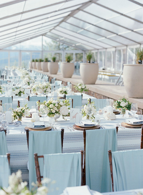 Large Clear Tent Filled with Wedding Reception Tables with Light Blue, White and Green Colors