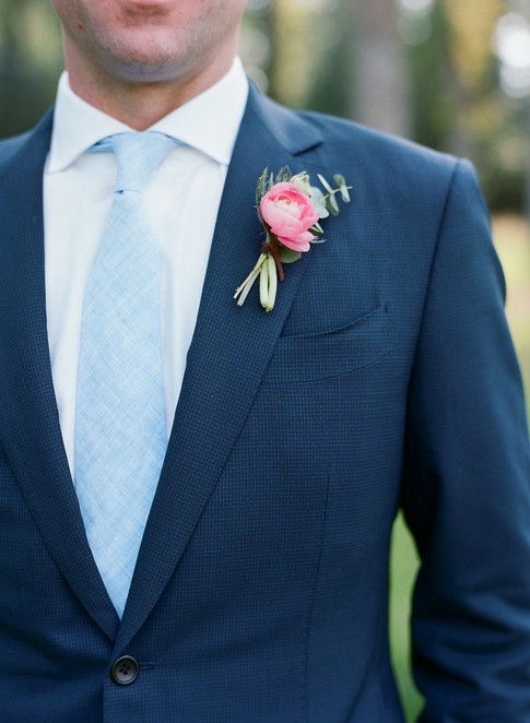 Groom's suit with a Pink Ranunculus Boutonniere