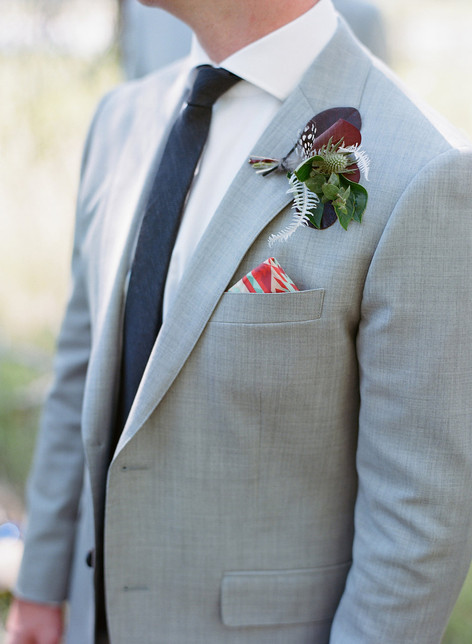 Green Boutonniere on a Man's Suit