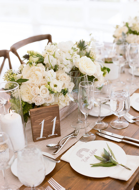 Wooden Table with White and Green Flowers and Wooden Block with Table Number 11