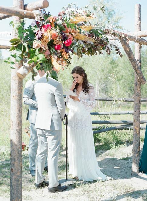Bride and Groom under an Aspen Wood Chuppa
