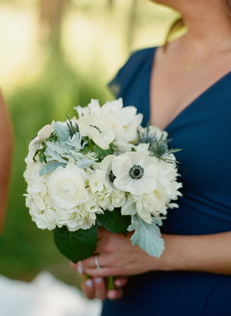 Woman Holding a Bouquet with White Roses and Anemones