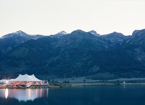 White Wedding Tent Reflecting in a Lake in front of the Teton Mountains