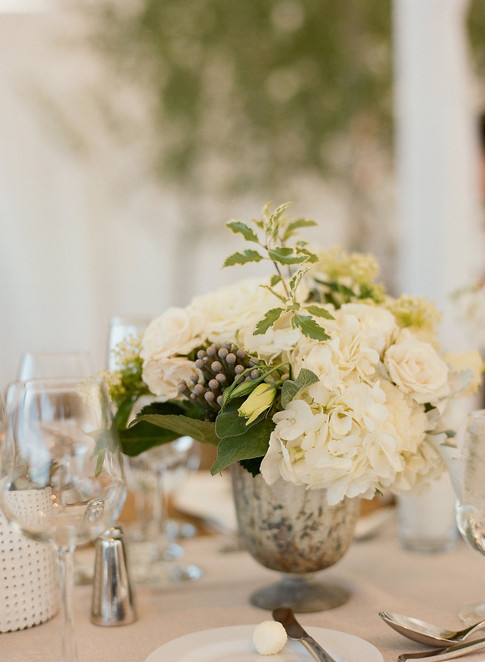 White Flower Arrangment with Brunia Berries in a Tall Distressed Silver Vase