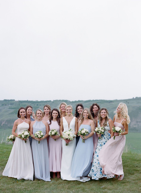 Bride and Bridesmaids wearing Pastel Dresses on a Mountainside