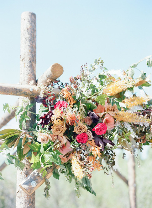 Pink, Orange, Purple Flowers on an Aspen Wood Wedding Chuppa