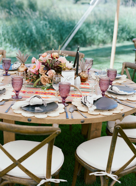 Round Wedding Reception Table with Boho Decor
