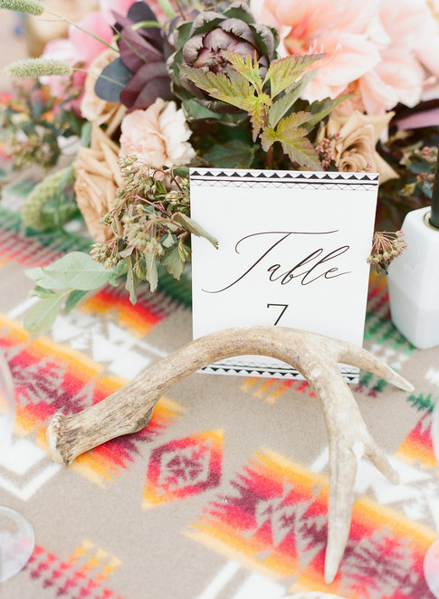 Flowers, Table Marker and Antler on a Pendleton Tablecloth
