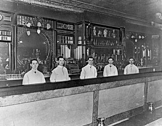 1024px-Five_bartenders_behind_St._Charle