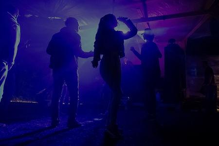 silhouette of people standing on stage_edited.jpg
