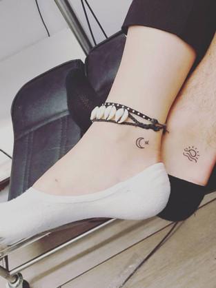 sun-moon-leg-small-couple-tattoo