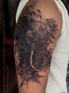 Elephant Tattoo on arm | Aliens Tattoo