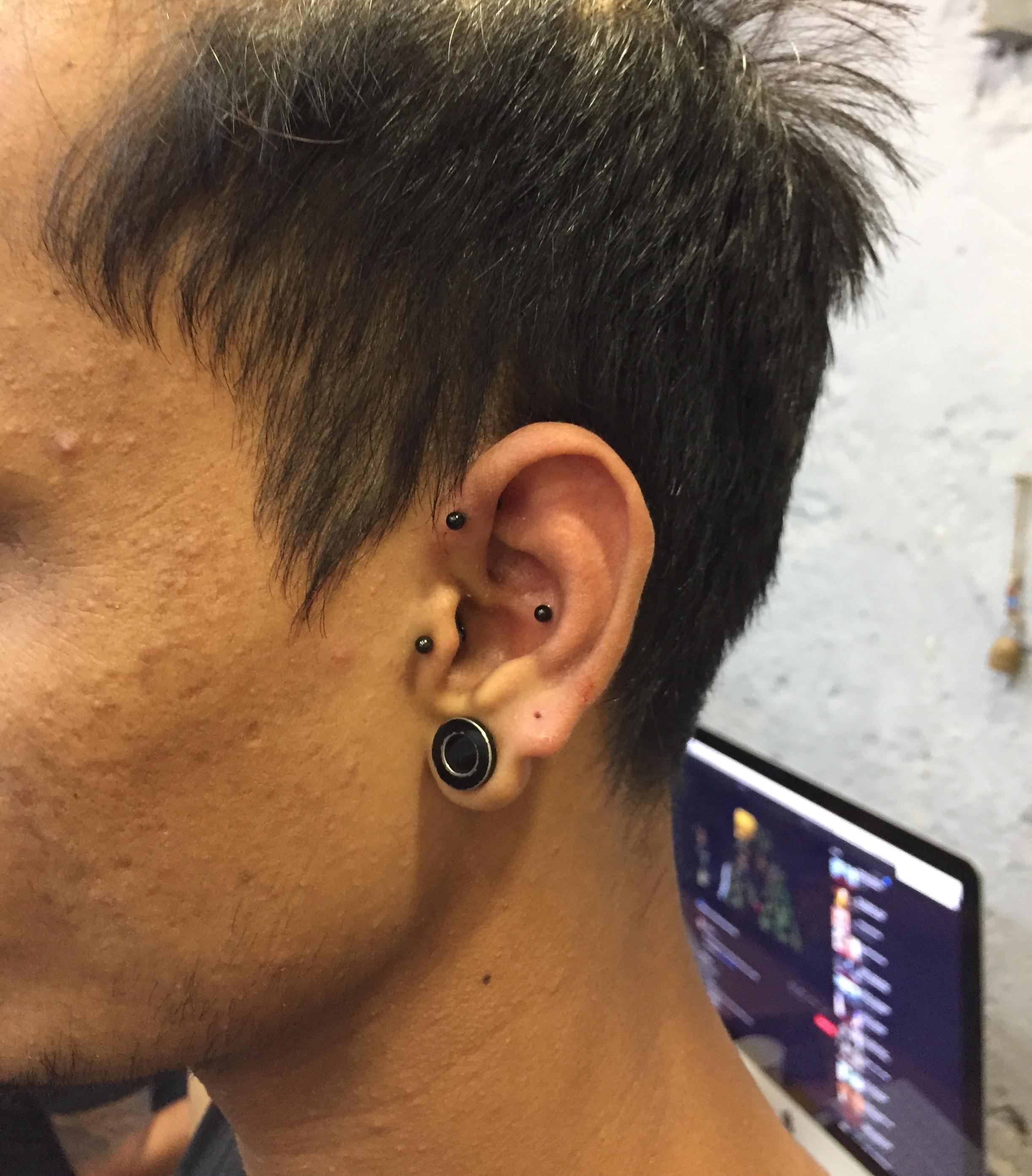 EAR TRIANGLE PIERCING