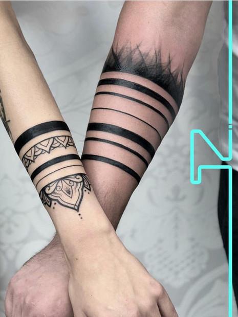 geaometric-armband-couple-tattoo