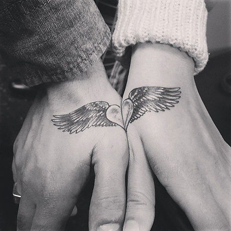 Angel-Winged-Heart-Couple-Tattoo.jpg