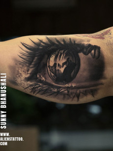 Realistic eye tattoo by Sunny Bhanushali
