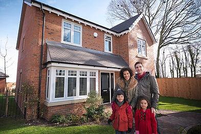 Family-smiling-outside-house - Copy.jpg