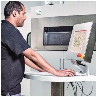 man preparing 3d print