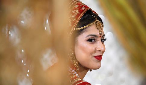 Bride through curtains