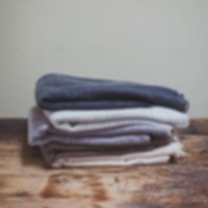 hb pile of large cashmere scarves.jpg